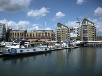 Limehouse Marina with passing Docklands Light Railway train