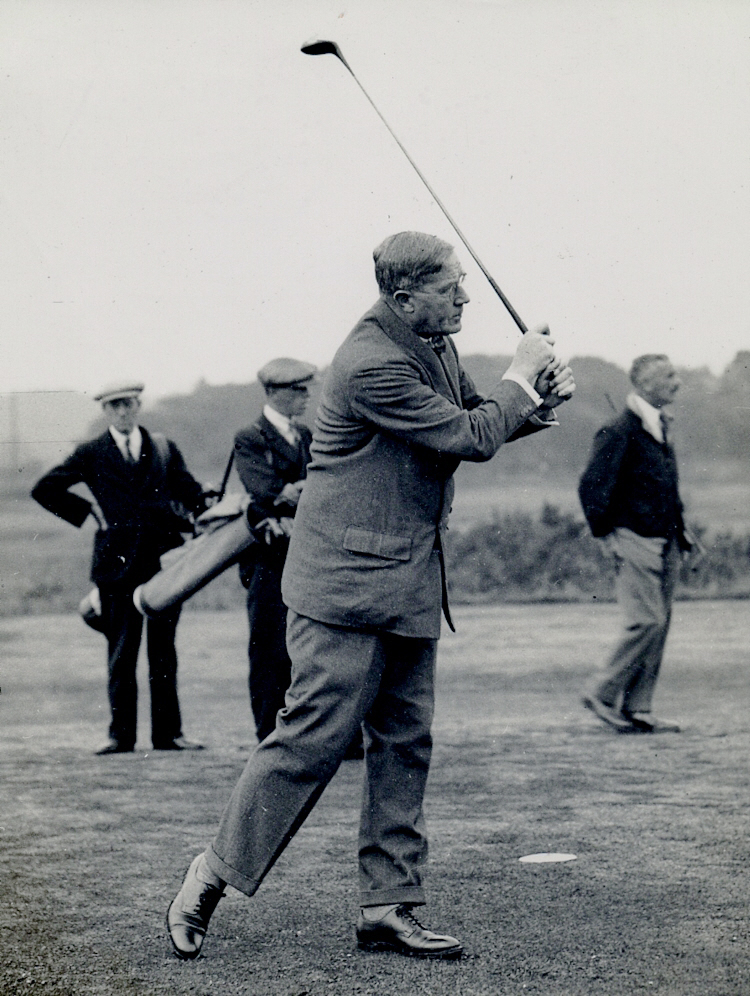 WH playing golf