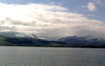 View of Snowdonia from Plas Newydd across the Menai Strait