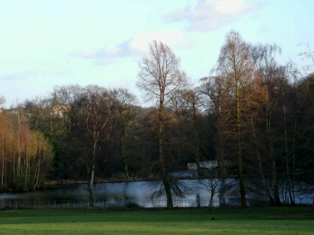 Kenwood lake with distant view of false bridge