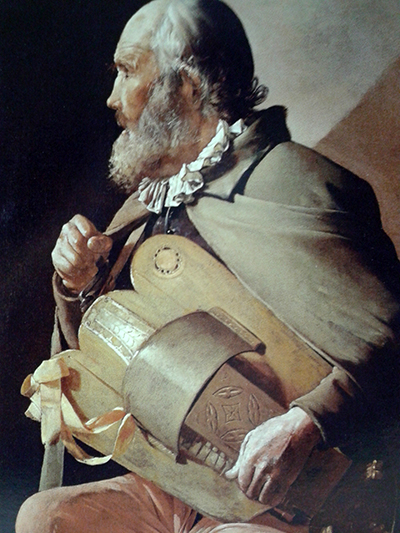a Tour - The Blind Hurdy Gurdy Player