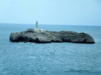 There is a little outcrop with lighthouse at the harbour entrance
