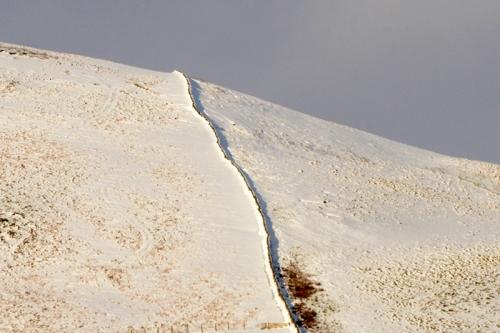 stone dyke in snow