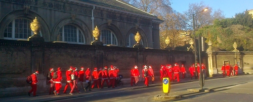 A saturation of Santas outside the Queen's Gallery
