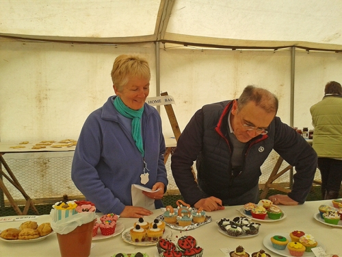 Bon and Nancy judging the cakes
