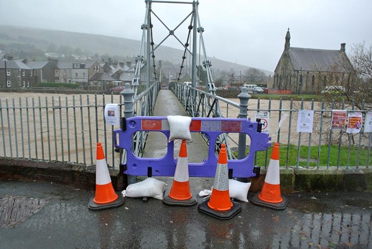 suspension bridge in flood