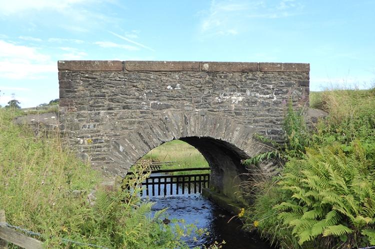 Bridge near water of Milk