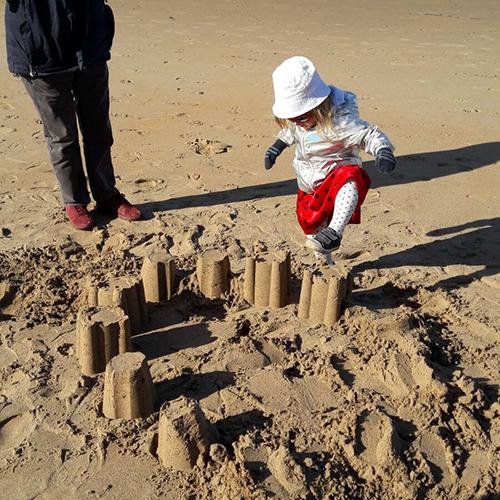 Matilda stamping on sand castles