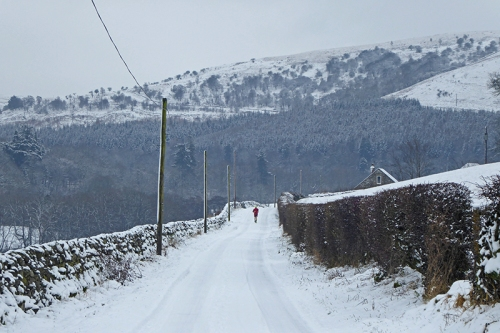 jogger on Potholm road in snow