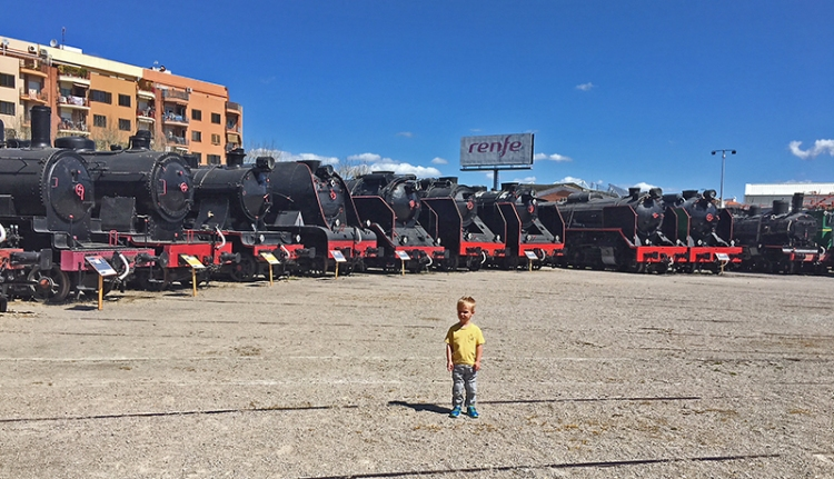 Elliot Graham surrounded by trains at Vilanova Railway Museum