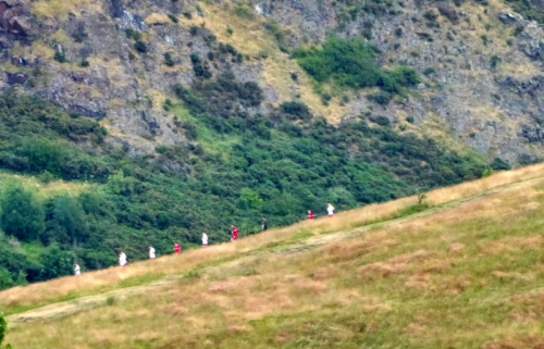 runners on Salisbury Crags