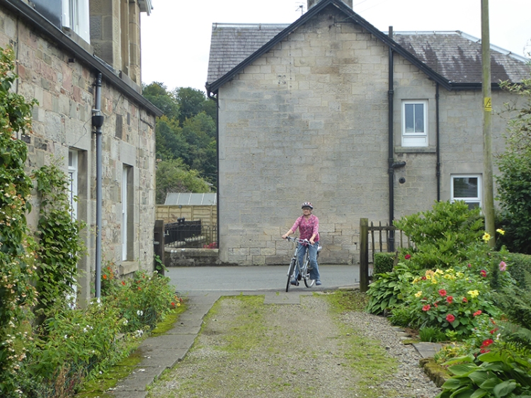 Mrs T entering on cycle