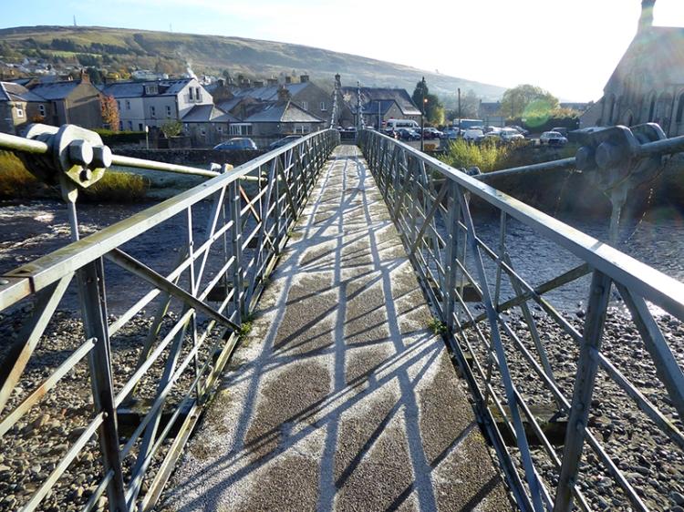 suspension bridge with ice