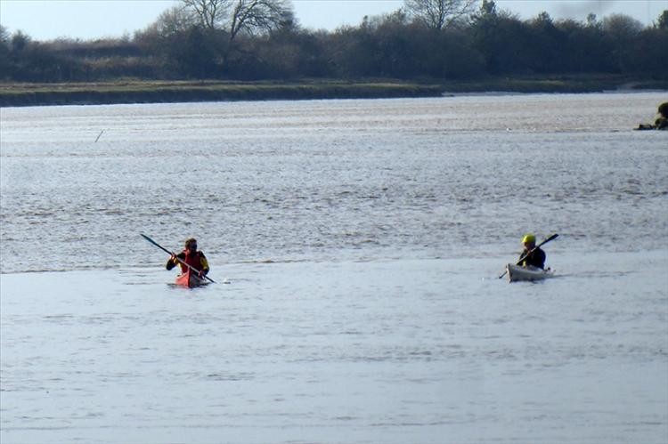 canoeists follwoing bore
