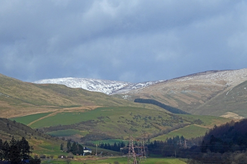 ewes valley with diostant snow