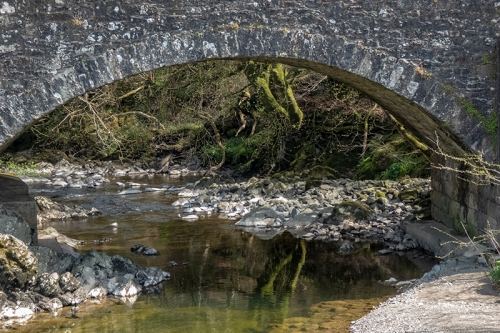 auld stane bridge with reflection