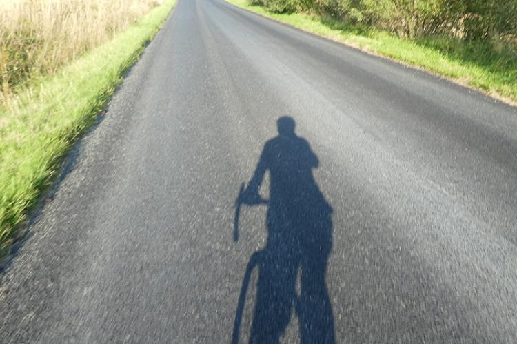shadowy cyclist