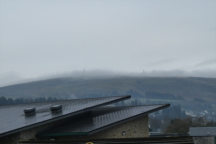 Whita in low cloud