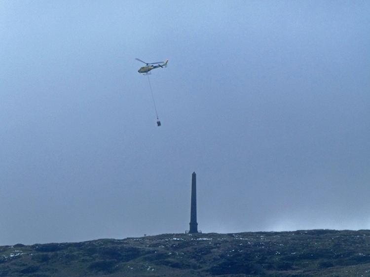 helicopter over monument