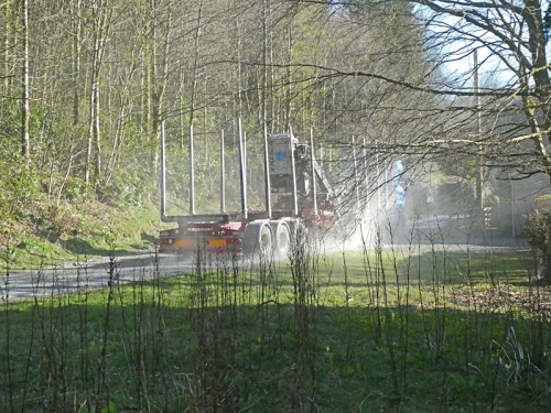 log lorry passing