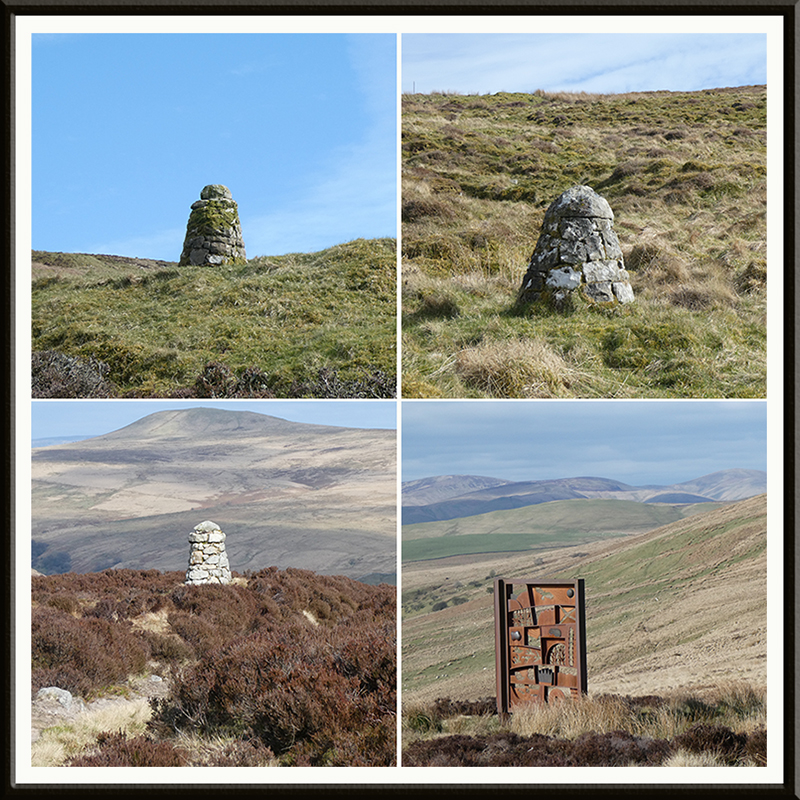 three cairns and a memorial